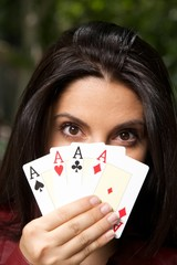 pretty woman with four aces in her hand.