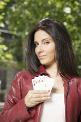 pretty woman with four aces in her hand