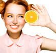 Beauty Model Girl with Juicy Oranges
