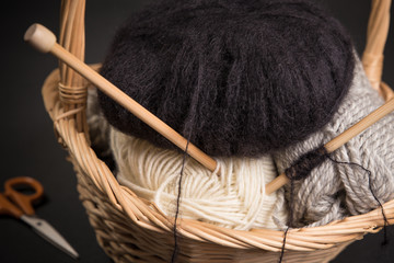 Mohair and yarns and needles in knitting basket.