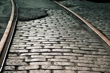 Old train rails on cobblestone street