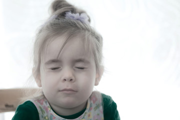 Child with closed eyes