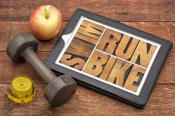run, bike, swim - fitness concept