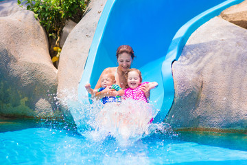 Mother and kids at water slide