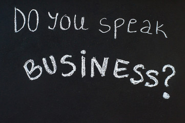 Do you speak business? message written on blackboard