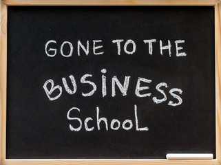 Gone to the business school message written on blackboard