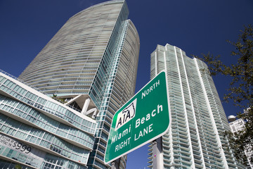 Miami beach billboard under skyscrapers