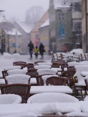 snowy chairs tables winter
