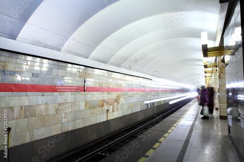 Russia, St. Petersburg, passengers stand on the platform subway