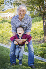 Chinese Grandpa Having Fun with His Mixed Race Grandson Outside
