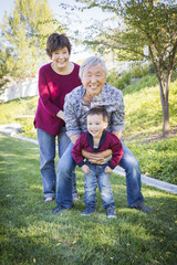 Chinese Grandparents Having Fun with Their Mixed Race Grandson O