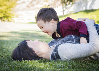 Chinese Mother Having Fun with Her Mixed Race Baby Son