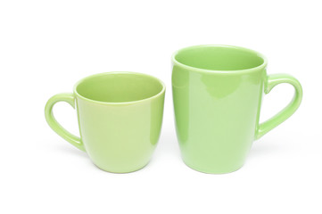 Two green mugs empty blank, isolated on white background