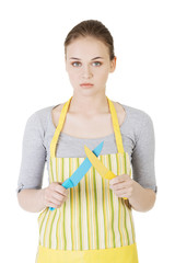 Housewife holding rolling pin