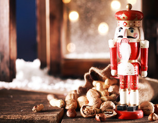 Nutcracker and Nuts on Wooden Table