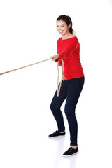 Young woman pulling a rope