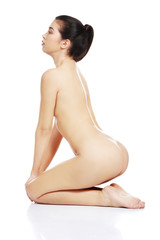 Naked woman kneeling