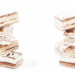 Few pieces of nougat stacked together on white