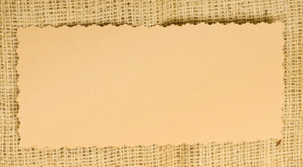 Old paper tag on natural burlap