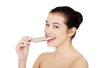 Woman eating crisp bread