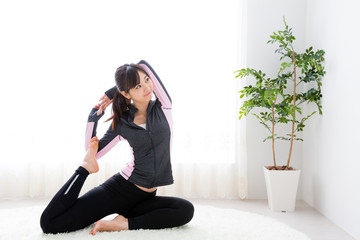 sporty asian woman exercising