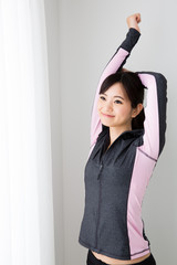 sporty asian woman on white background