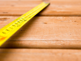 Tape measure on a wooden deck