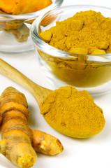 Turmeric (Curcuma longa L.) root and powder.
