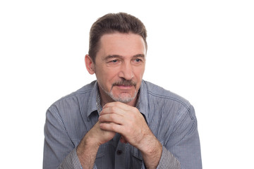 thinking age man beard with grey shirt