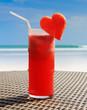 Fruity cocktail on a beach table