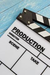 Movie slate film on blue wooden table