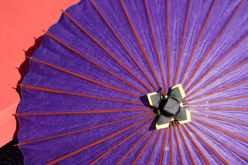 Japanese traditional purple umbrella with bench