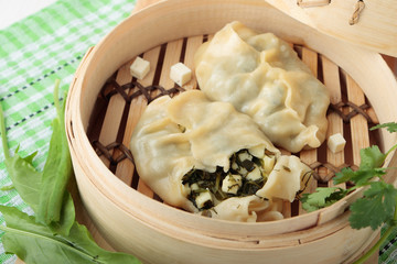 Dumplings of wheat flour with greens and and cheese