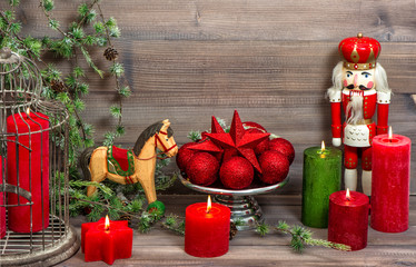 christmas decorations with red candles, baubles, antique toys