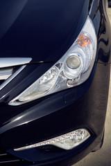 Headlight of black car