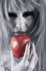 witch holding an apple