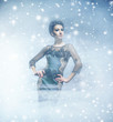 Young and emotional woman in a fashion dress on the snow