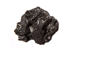 Lump of charcoal over white background