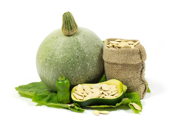 Small and Big Pumpkins and Pumpkin Seeds in Jute Bag Isolated