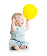 Cheerful baby with ballon in hand