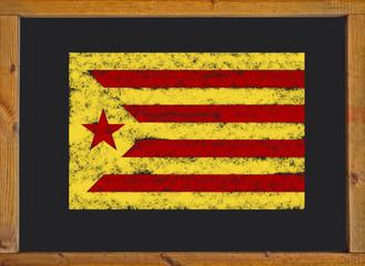 The Catalan independence flag (Estelada groga) on a blackboard