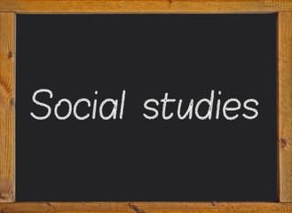 Social studies written on a blackboard