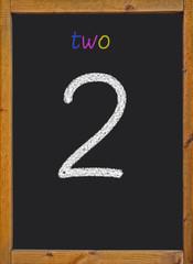 2 written on a black blackboard