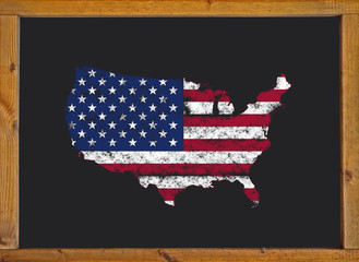 United States flag over the map on a blackboard