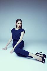 high fashion portrait of young elegant woman. Studio shot .