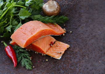 fresh salmon (red fish) fillet with herbs, spices and vegetables
