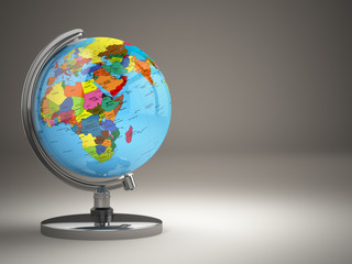 Globe with political map on grey background.