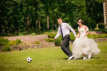 beautiful the couple in wedding day playing football