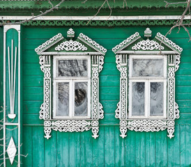 Russia. Suzdal. Two windows with carved wooden frames.