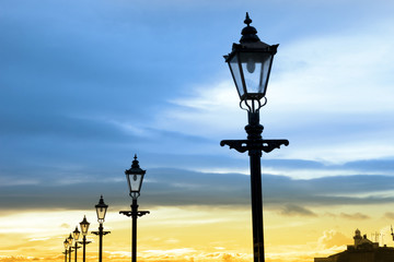 lighthouse and row of vintage lamps